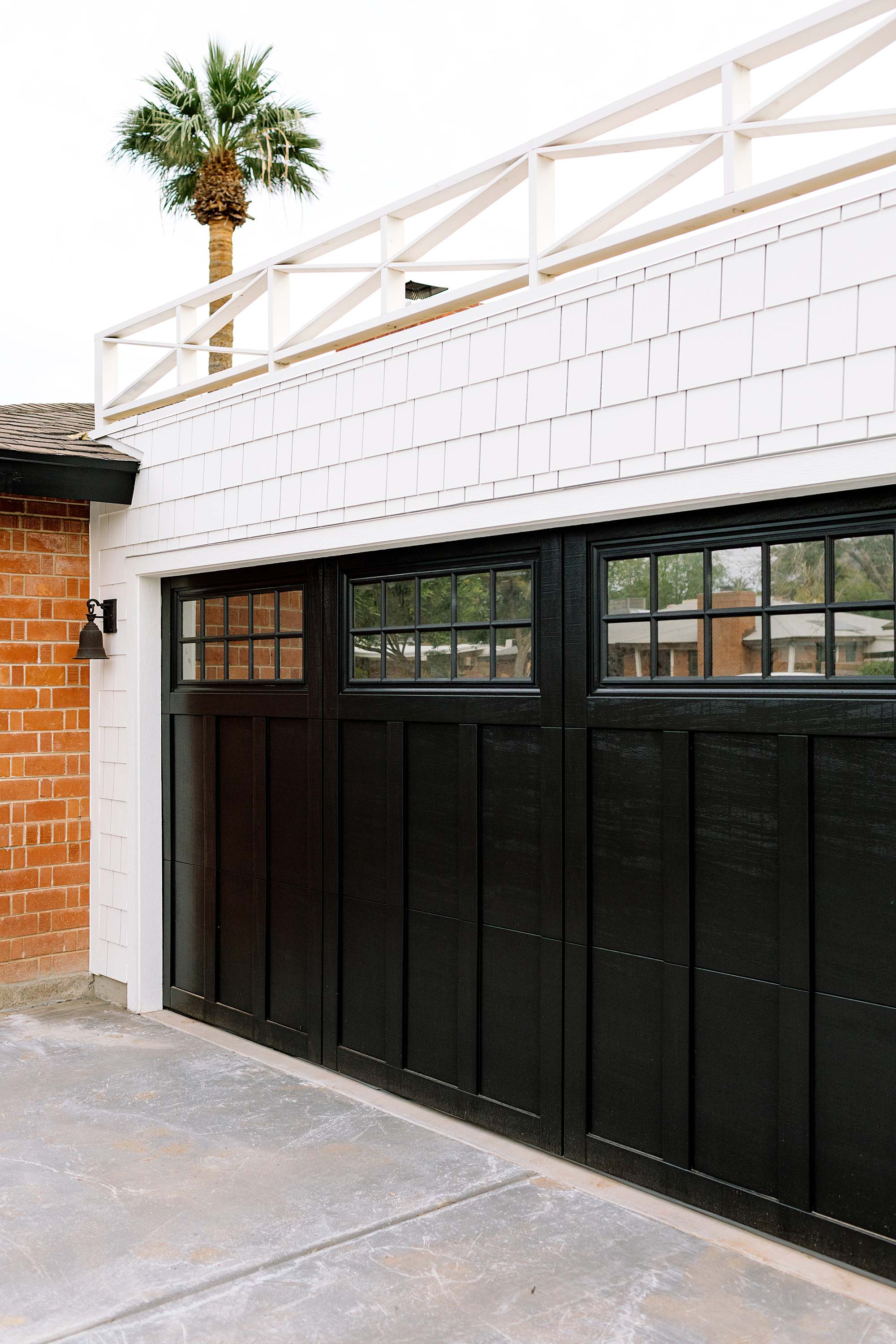 reflective tint for the flat roof garage with railing