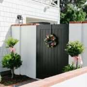 black side gate with floral spring wreath - arizona lifestyle blogger home and garden blog