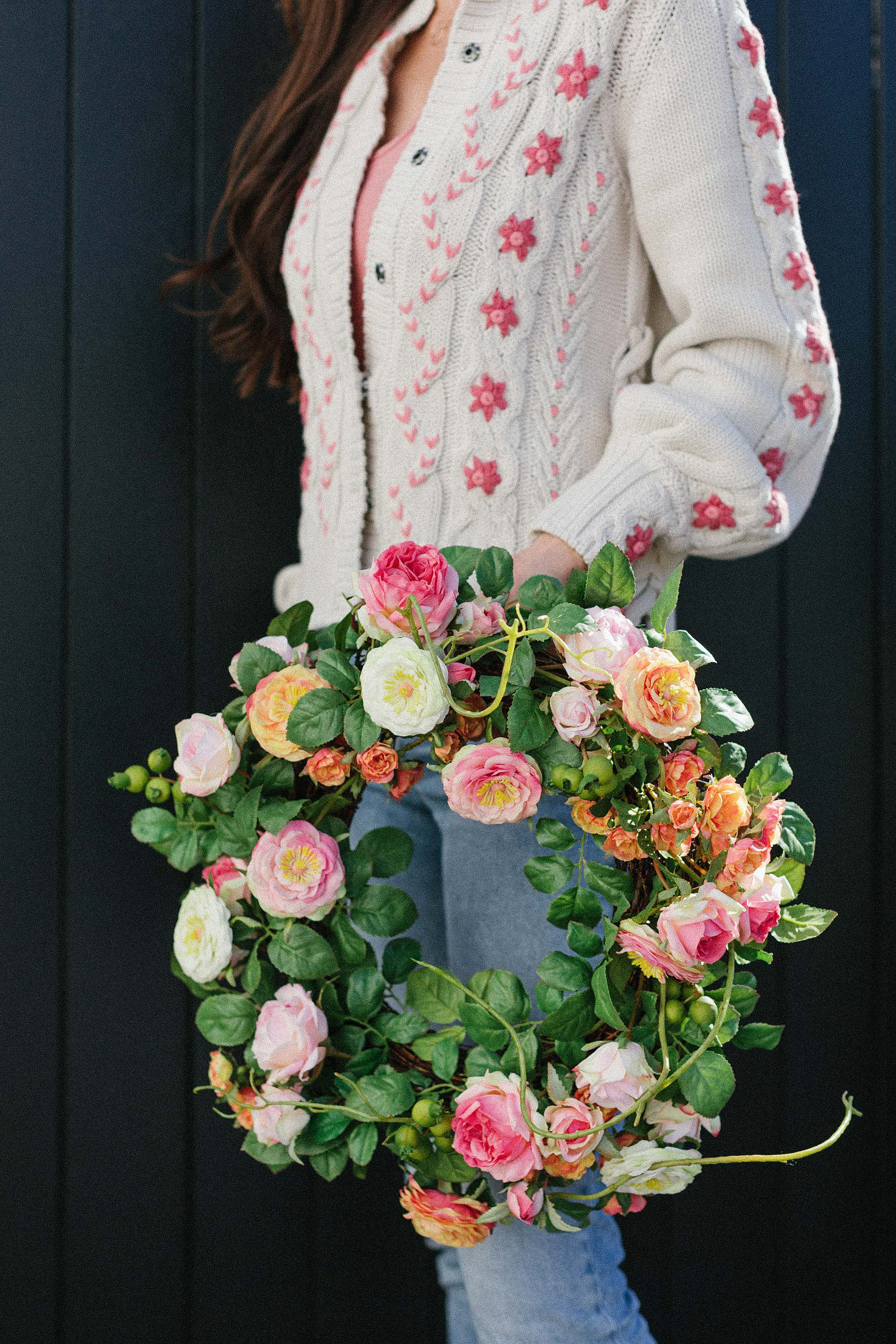 easter floral spring wreath from Macys - Phoenix Arizona lifestyle home and garden blogger Diana Elizabeth holding floral spring wreath