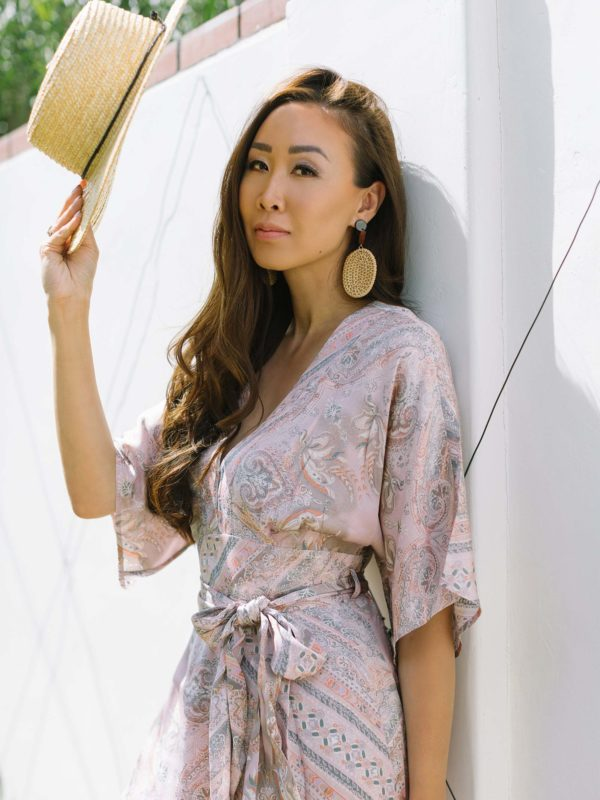 odd Molly radiant jumpsuit phoenix lifestyle blogger Diana Elizabeth leaning up against white wall with hat in shadows