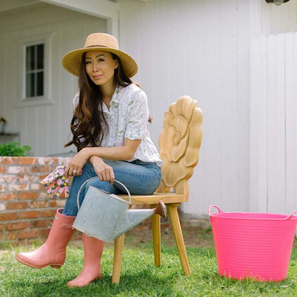 teak floral chair rose poppy gardener's backyard, garden lifestyle blogger Diana Elizabeth in garden hat, gloves and old watering can