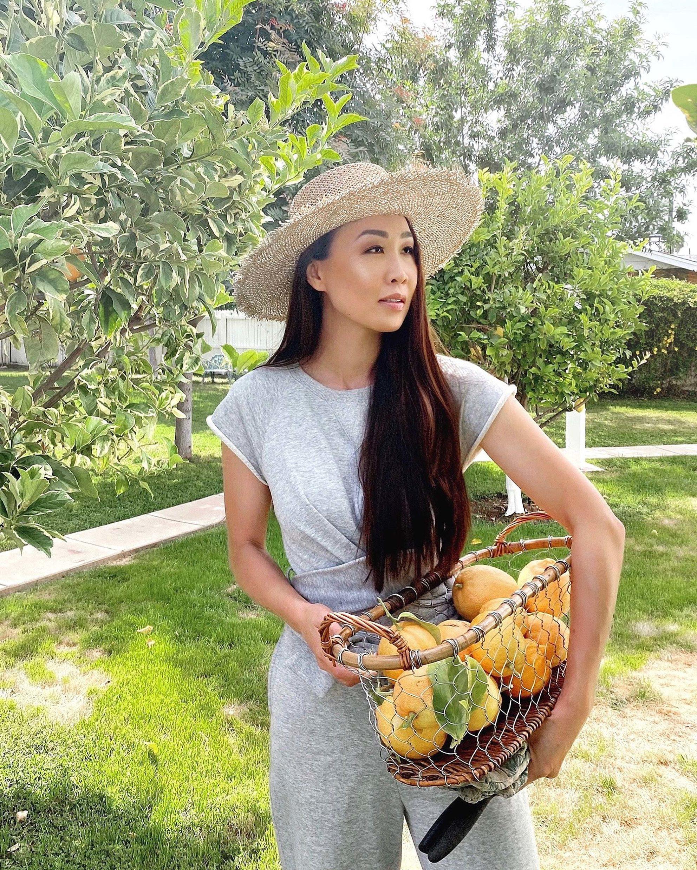 pink lemons in a basket, sweat jumpsuit straw hat garden lifestyle blogger Diana elizabeth