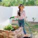 gardener holding hose by brick raised garden beds /lightweight durable hose by gilmour - garden backyard raised garden beds // arizona phoenix home and garden lifestyle blogger Diana elizabeth