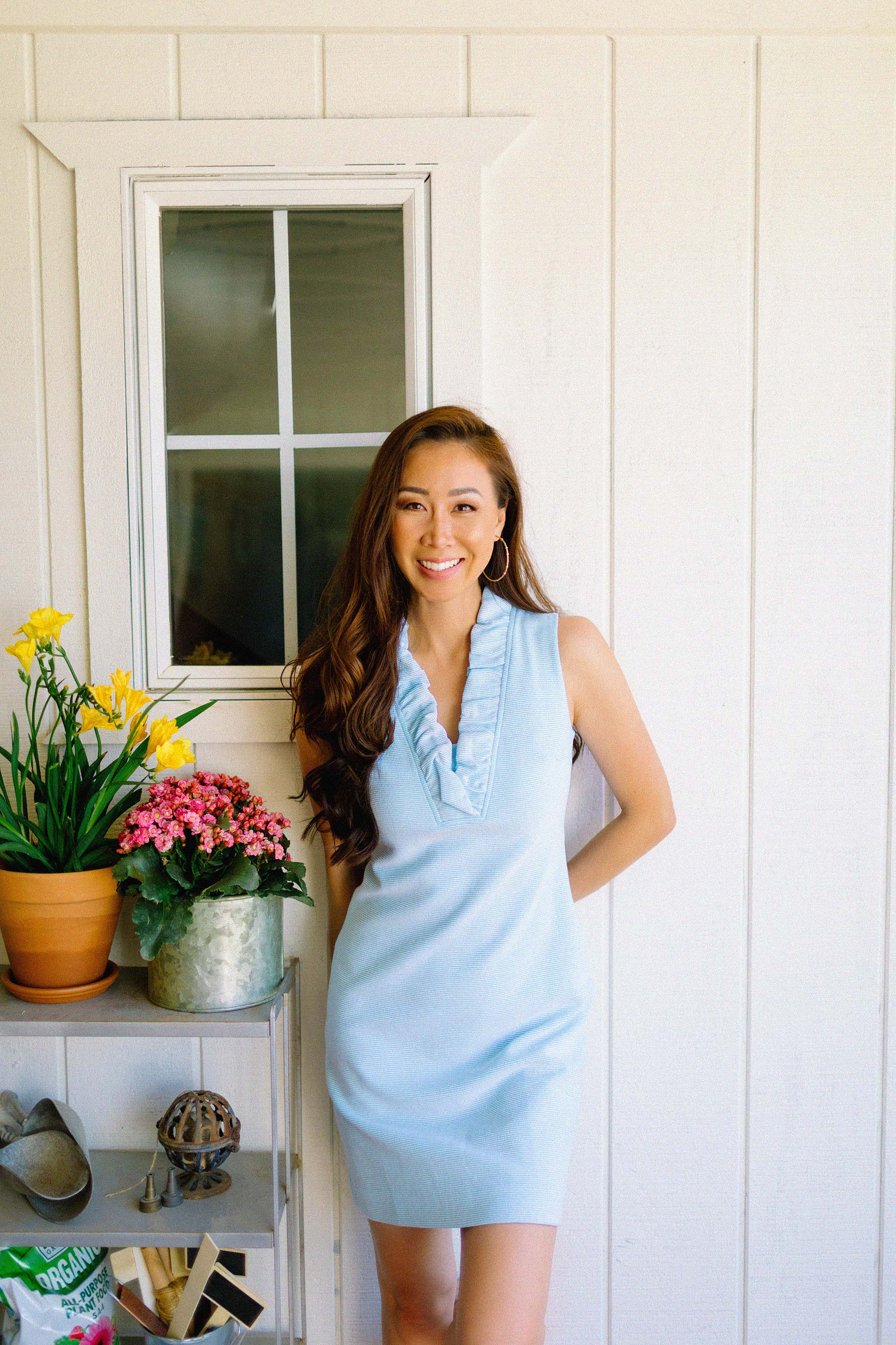 Lilly Pulitzer TISBURY SHIFT DRESS light blue ruffle neck dress details - spring dress looks, lifestyle blogger Diana Elizabeth leaning against the white wall with potted flowers #springdresses #lillypulitzer