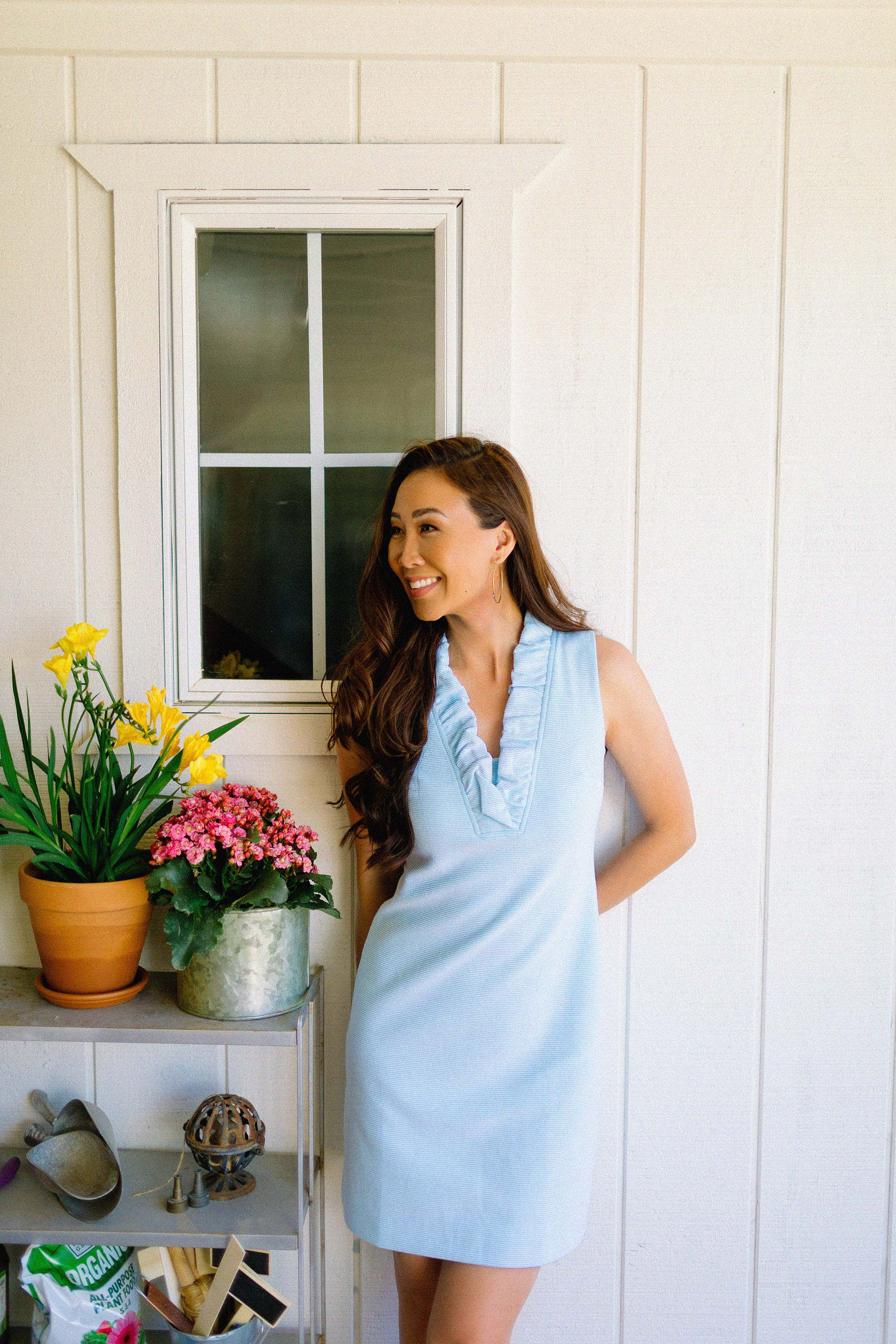Lilly Pulitzer TISBURY SHIFT DRESS ruffle blue spring dress on blogger in front of black gate going into garden