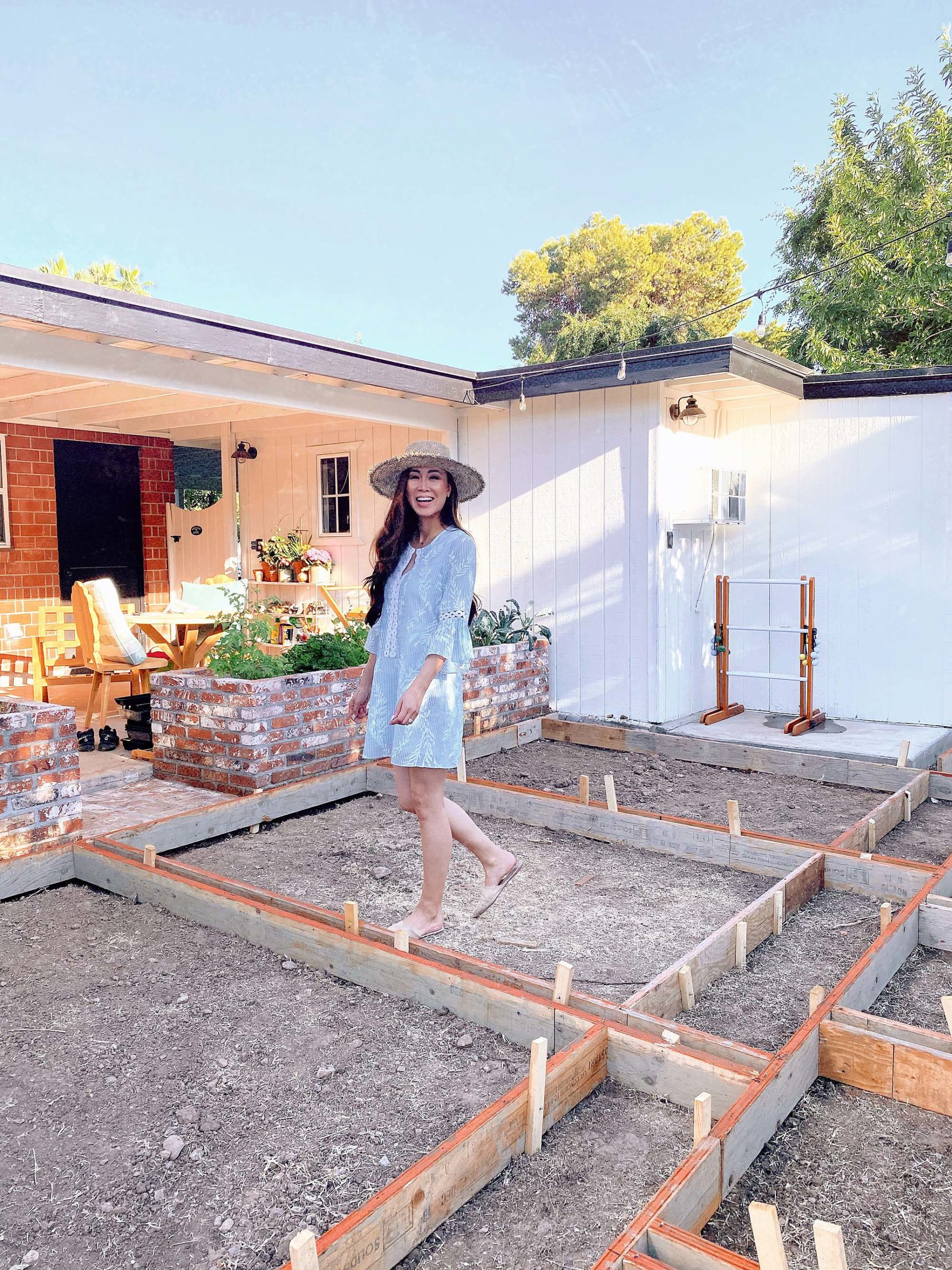 Phoenix lifestyle blogger standing in new garden area in cement frames ready for the pour. see progression photos of this unused front yard space turn garden area #garden #backyard