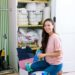 cleaning products for spring cleaning in front of wallpaper closet