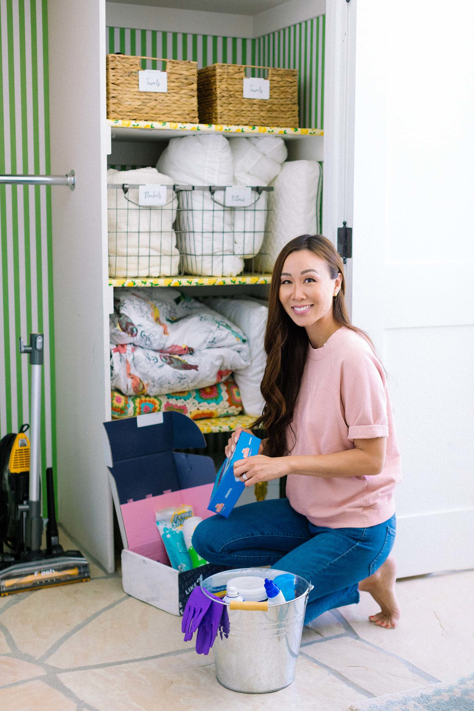 cleaning products for spring cleaning in front of wallpaper closet #closet #cleaninghacks