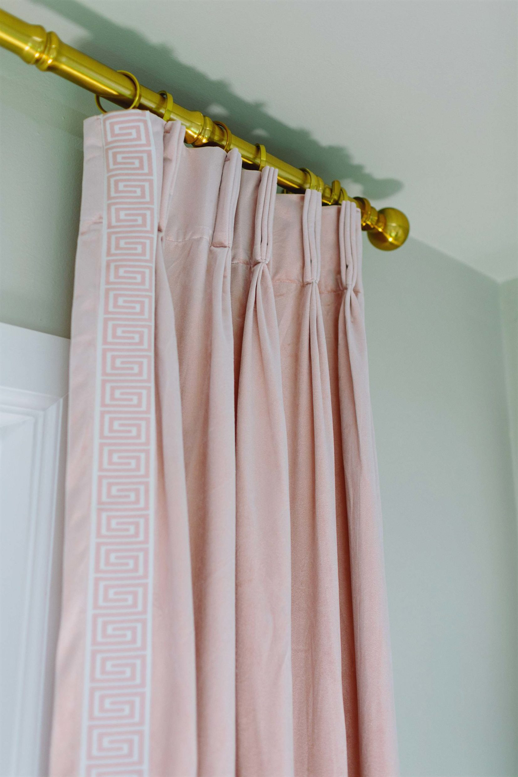 diy make it look like custom curtains with store bought pleated curtains - see blog post