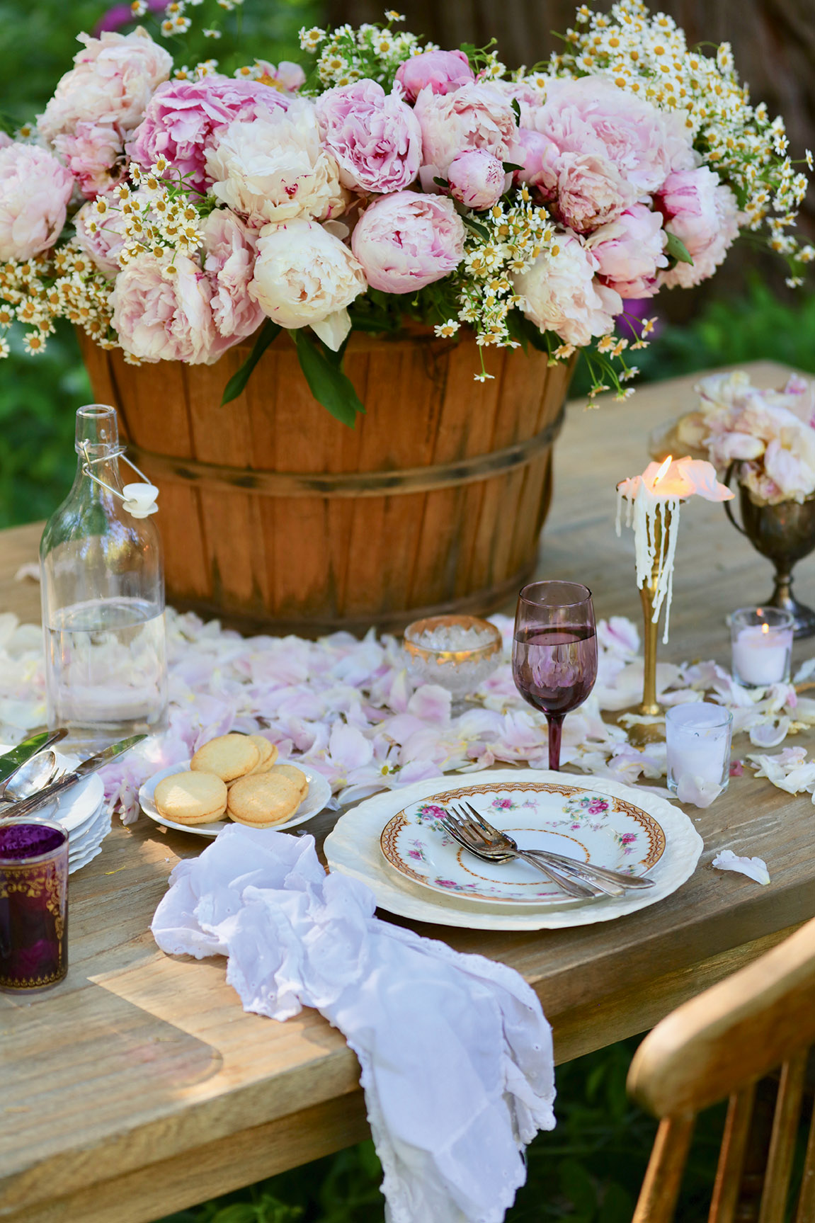 romantic flower petals table setting Photograph from French Country Cottage Inspired Gatherings by Courtney Allison. Reprinted by permission of Gibbs Smith Publishing.