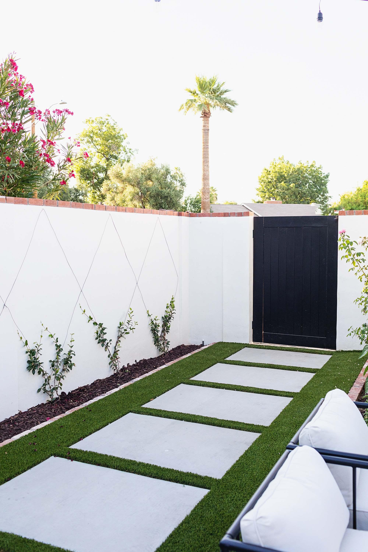 Progress photos final reveal of new garden area using artificial grass turf, See blog post for more photos! #viinewall #backyard