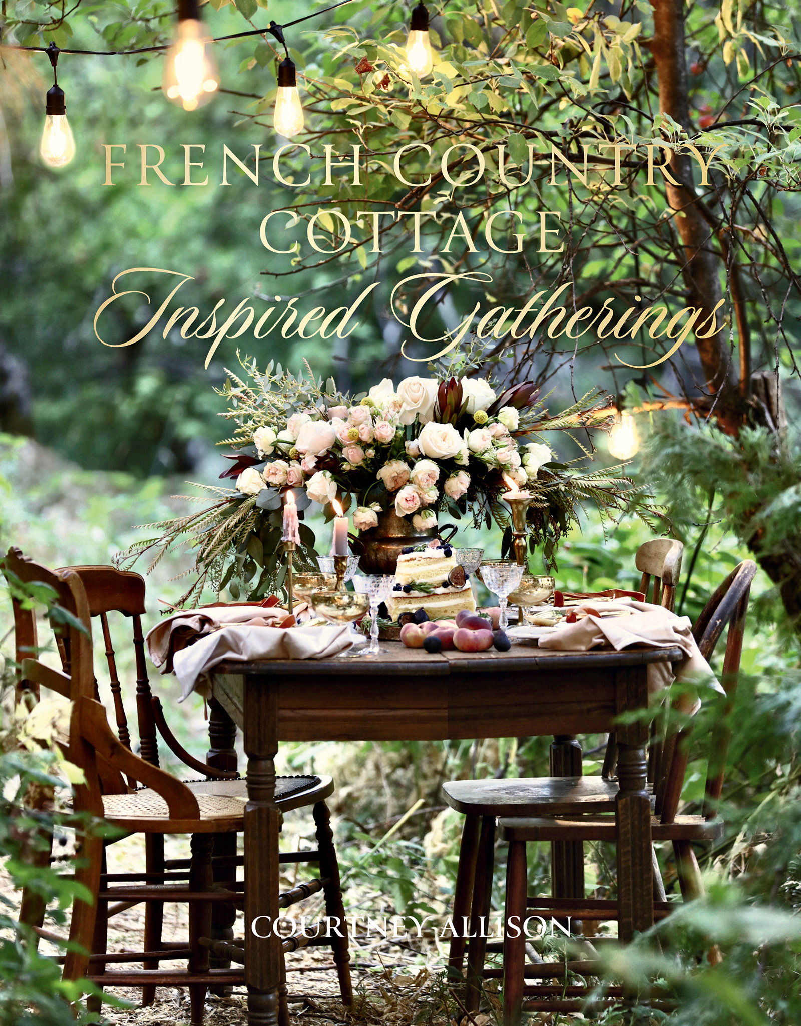 French romantic table setting in evening string lights / Photograph from French Country Cottage Inspired Gatherings by Courtney Allison. Reprinted by permission of Gibbs Smith Publishing.