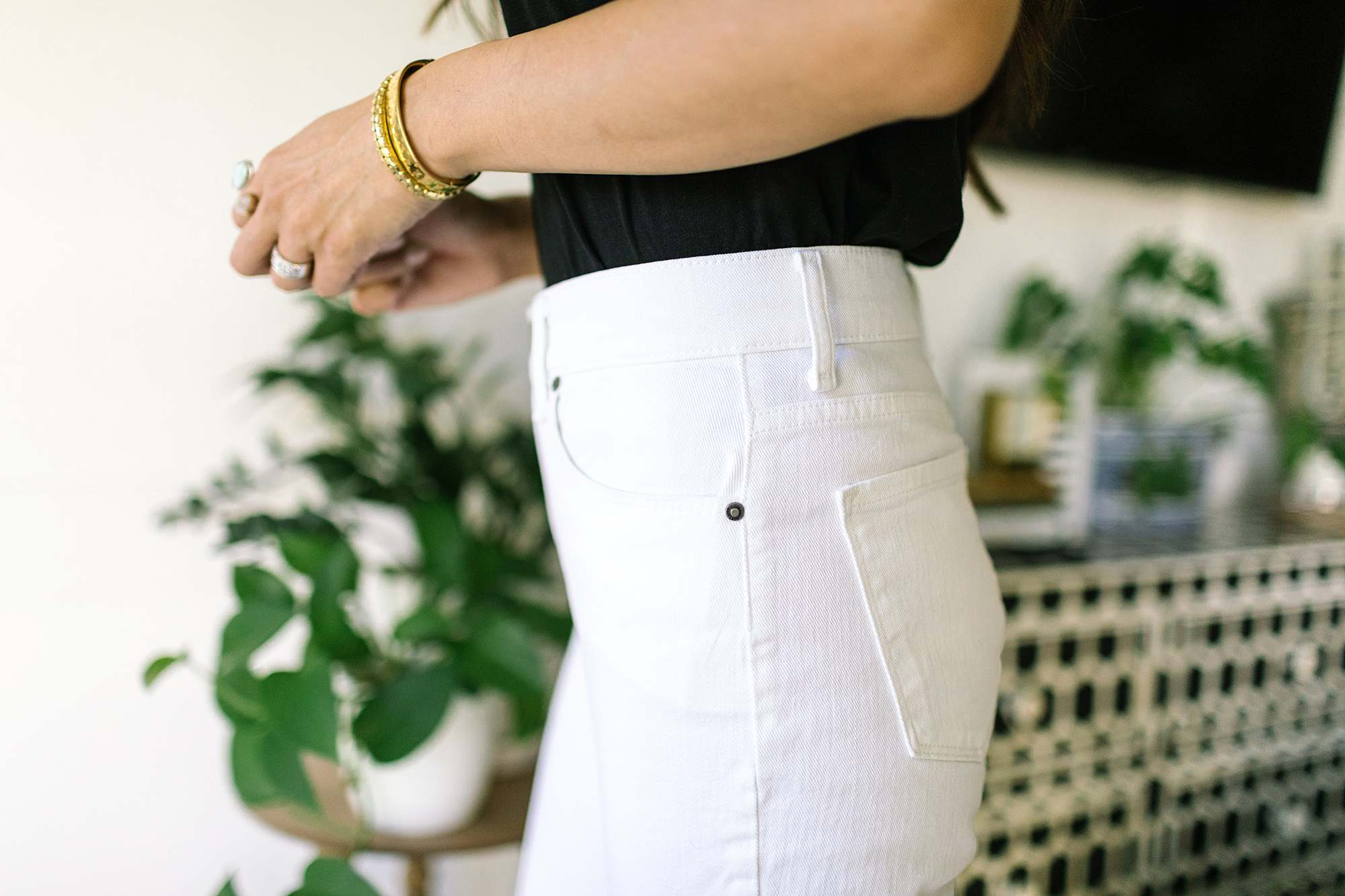 side profile of wearing white jeans with black shirt by Mott & bo