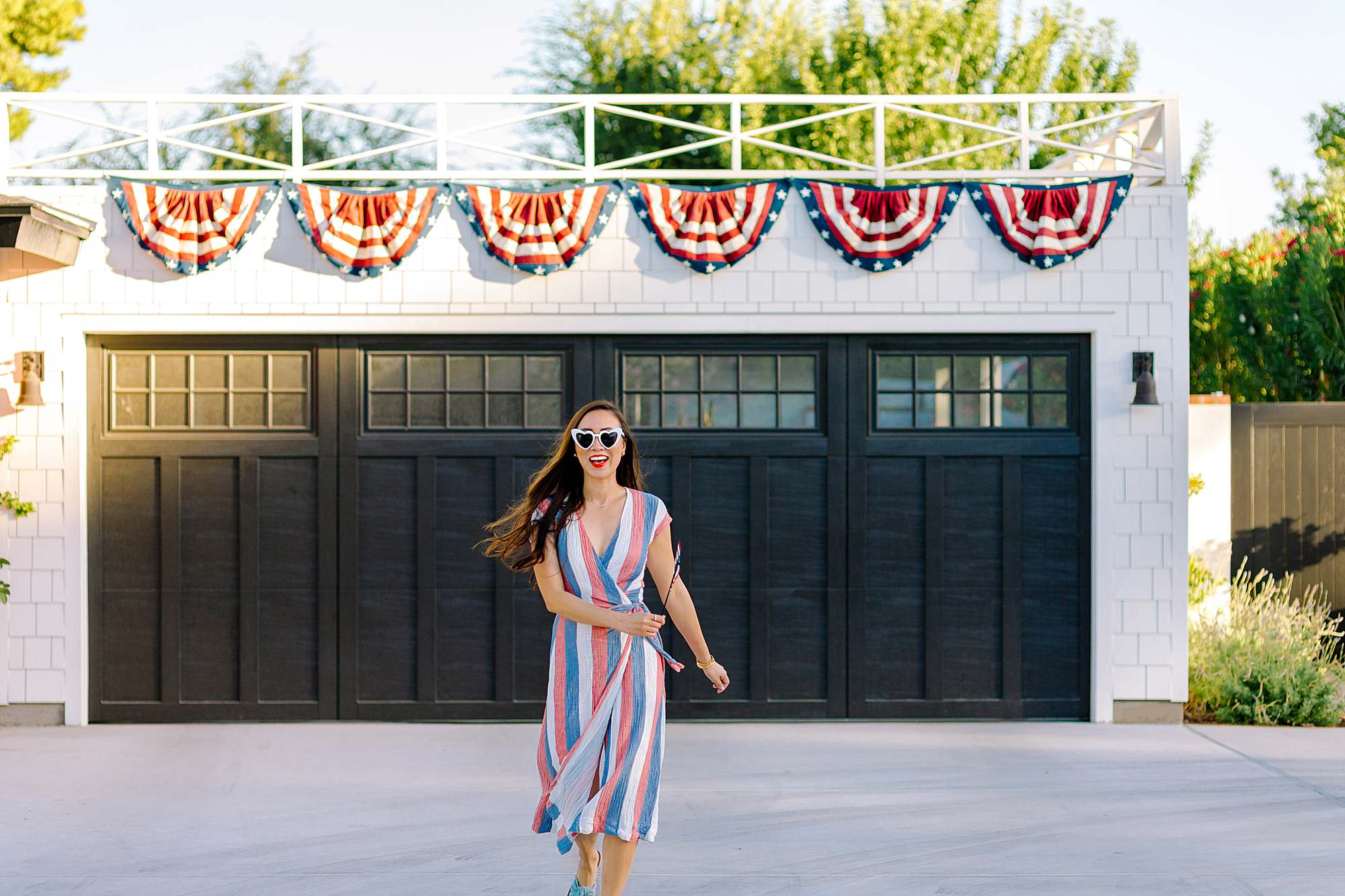 red white and blue dress for the Fourth of July, American flag bunting across the garage