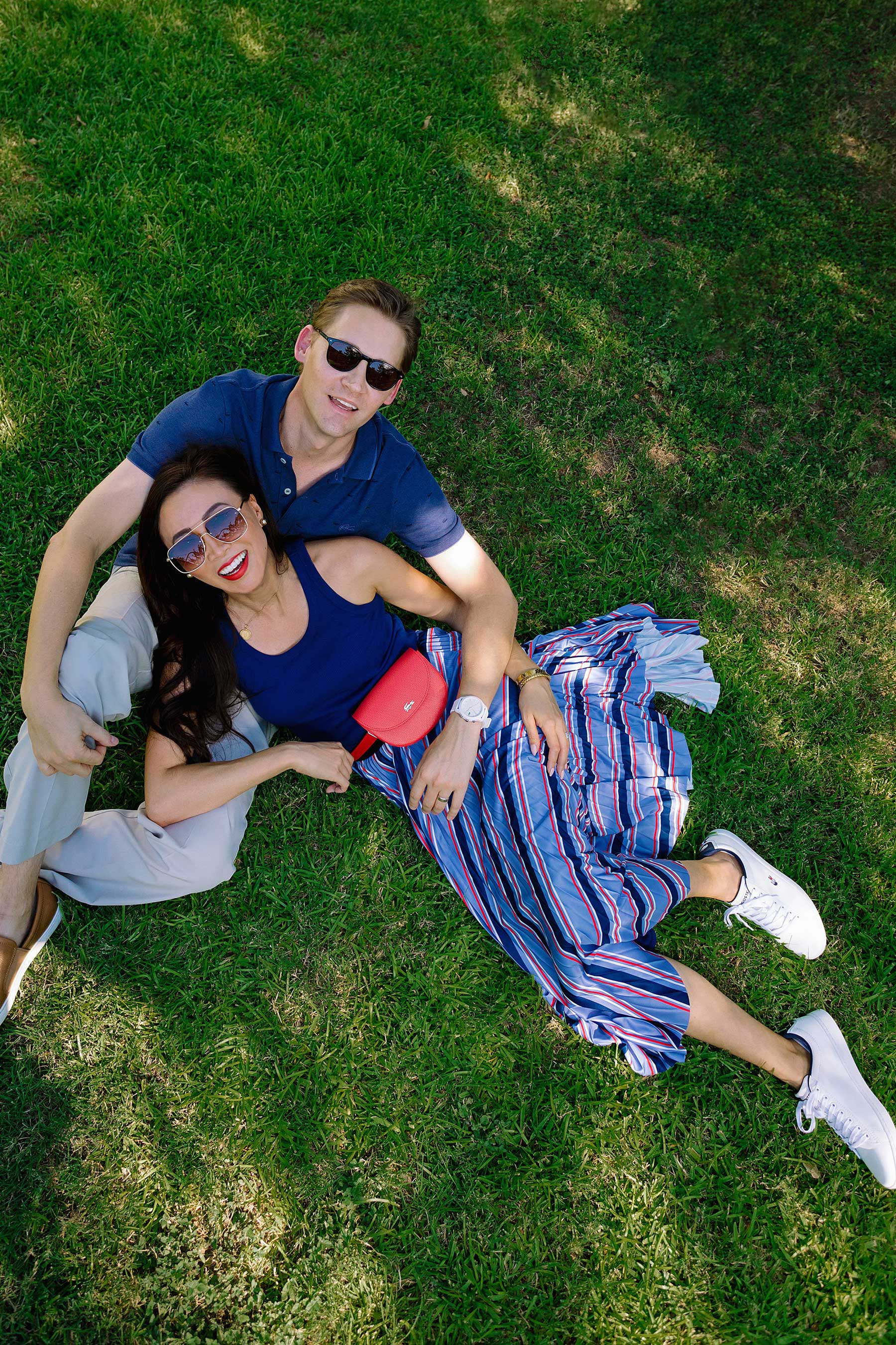 lacoste clothing couple photo in grass pose