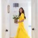 yellow flowy dress waking in hallway with flowers lifestyle and home blogger Diana Elizabeth based in Phoenix Arizona