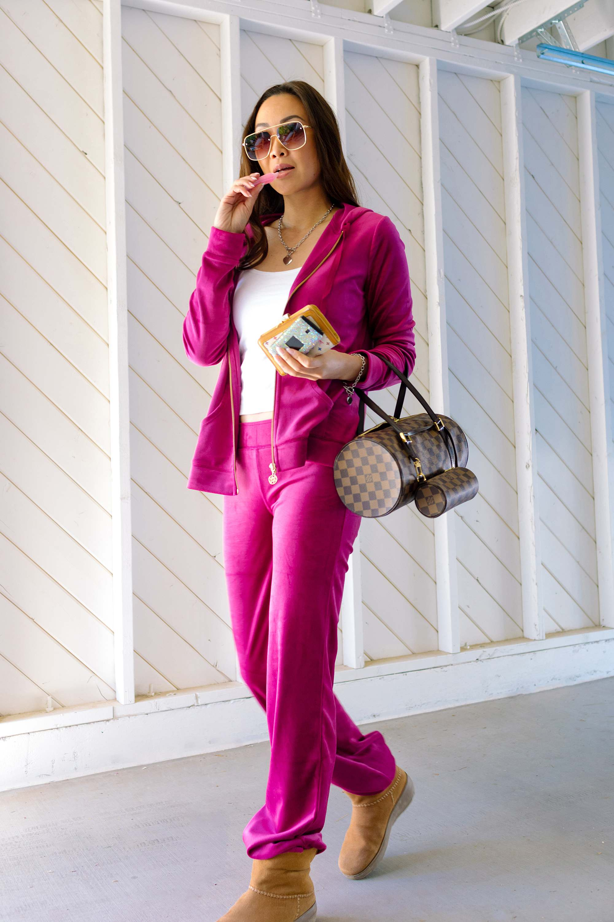 pink velour set early 2000s trend velour tracksuit is back outfit look