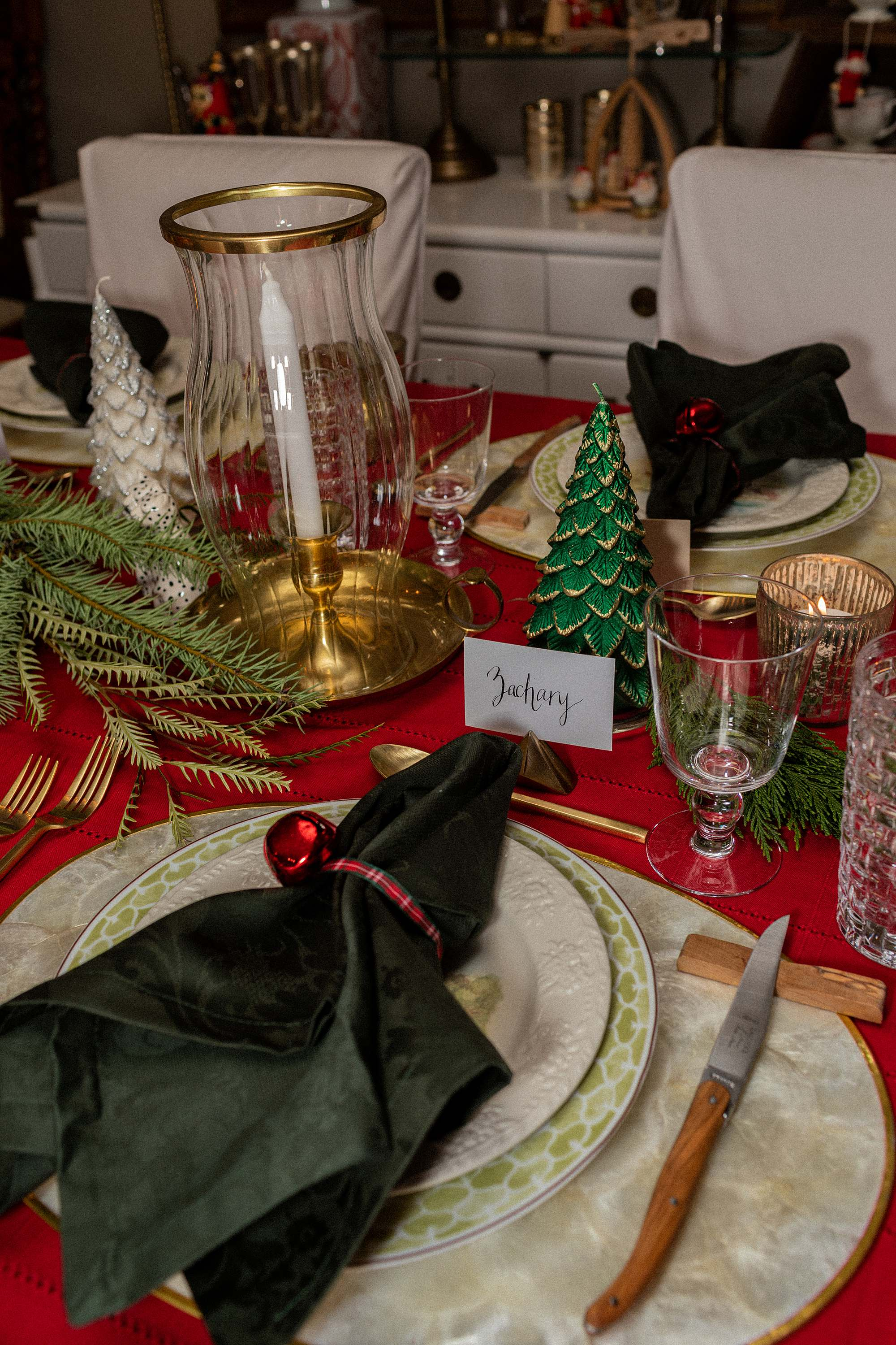 christmas tablescape red tablecloth brass candle hurricane