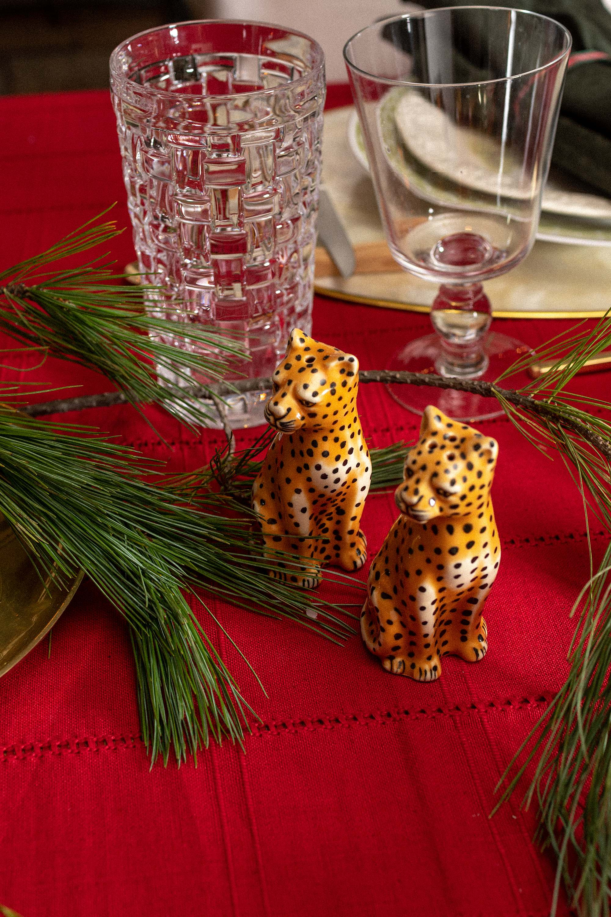 leopard salt and pepper shakers, holiday party christmas party red tablecloth