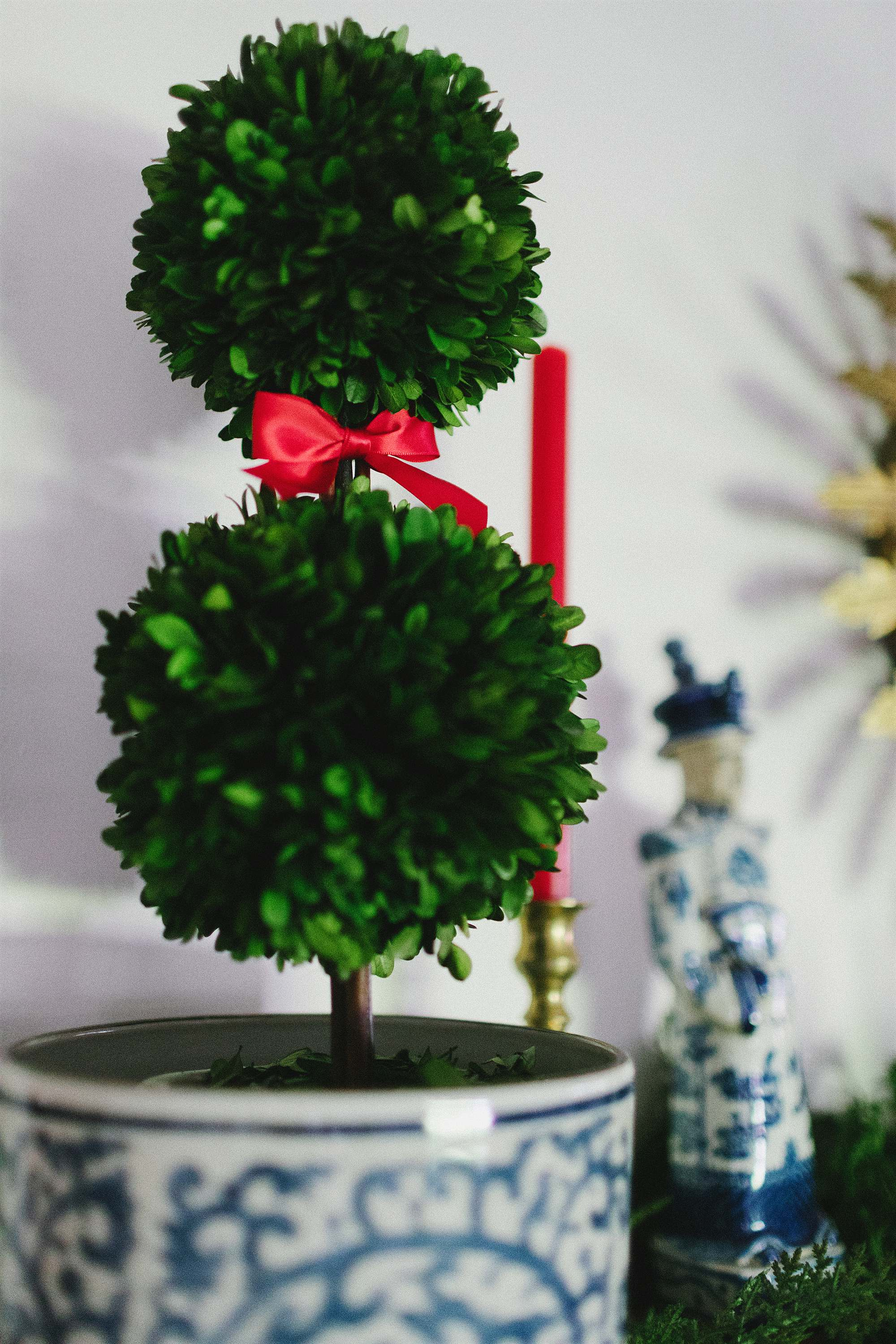 red bow on topiaries