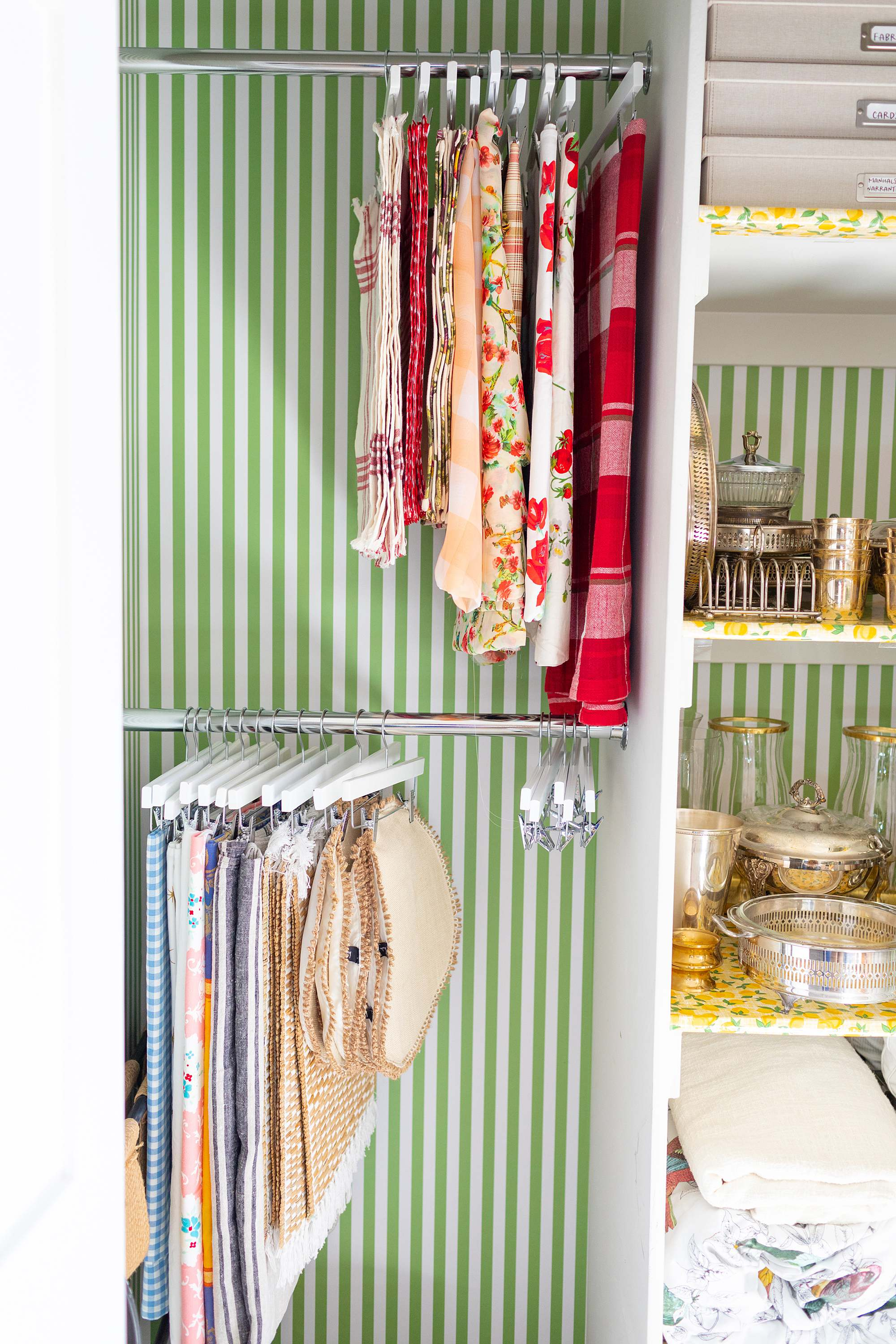 an entertaining closet for the hostess right off the dining room, organize linens and tablecloths and placements as well as serveware - it also serves as a guest closet. #organization Wallpaper closets #removablewallpaper