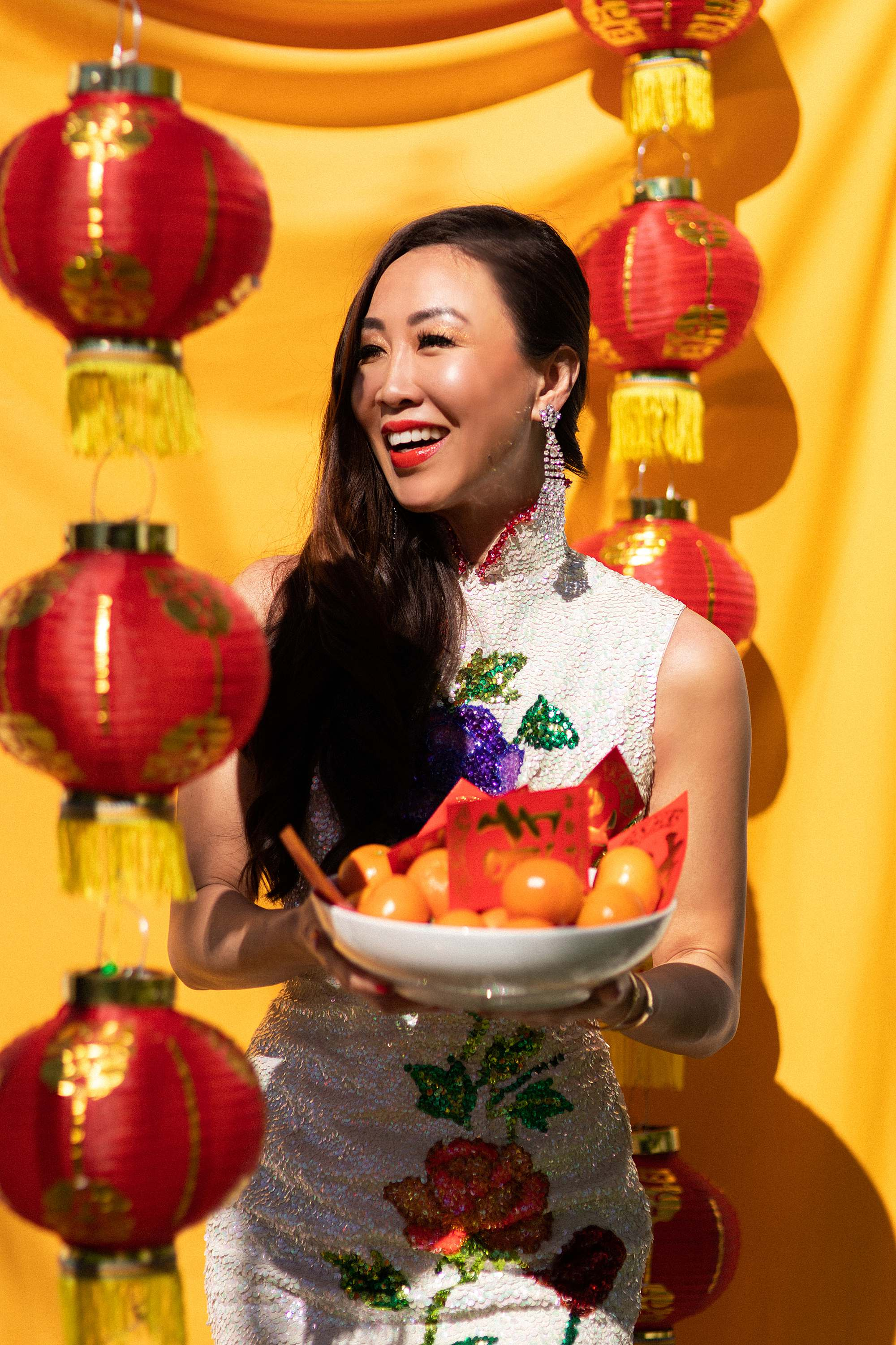 Chinese New Year lunar new year outfit and festivities - growing up Asian American blog post - DianaElizabethblog.com // Chinese girl in traditional sequin Chinese dress