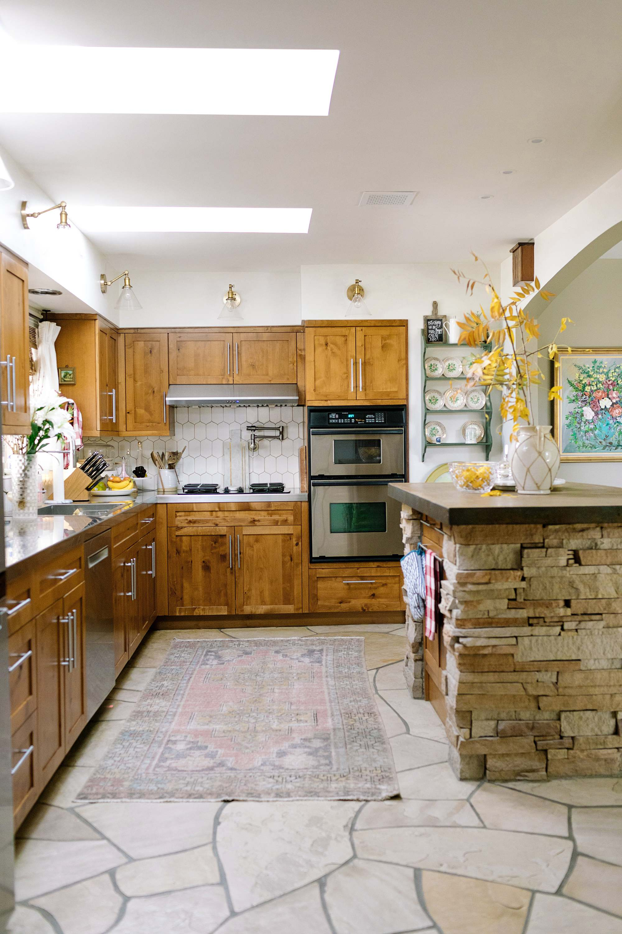 kitchen wall sconces clear glass flagstone floors, natural wood stained cabinets shaker style
