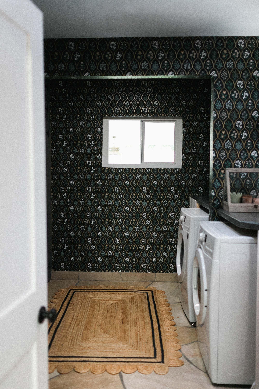 scalloped jute rug rifle paper co. Hawthorne wallpaper black linen floral wallpaper in mudroom laundry room English cottage vibes grandmillennial style - dianaelizabethblog.com
