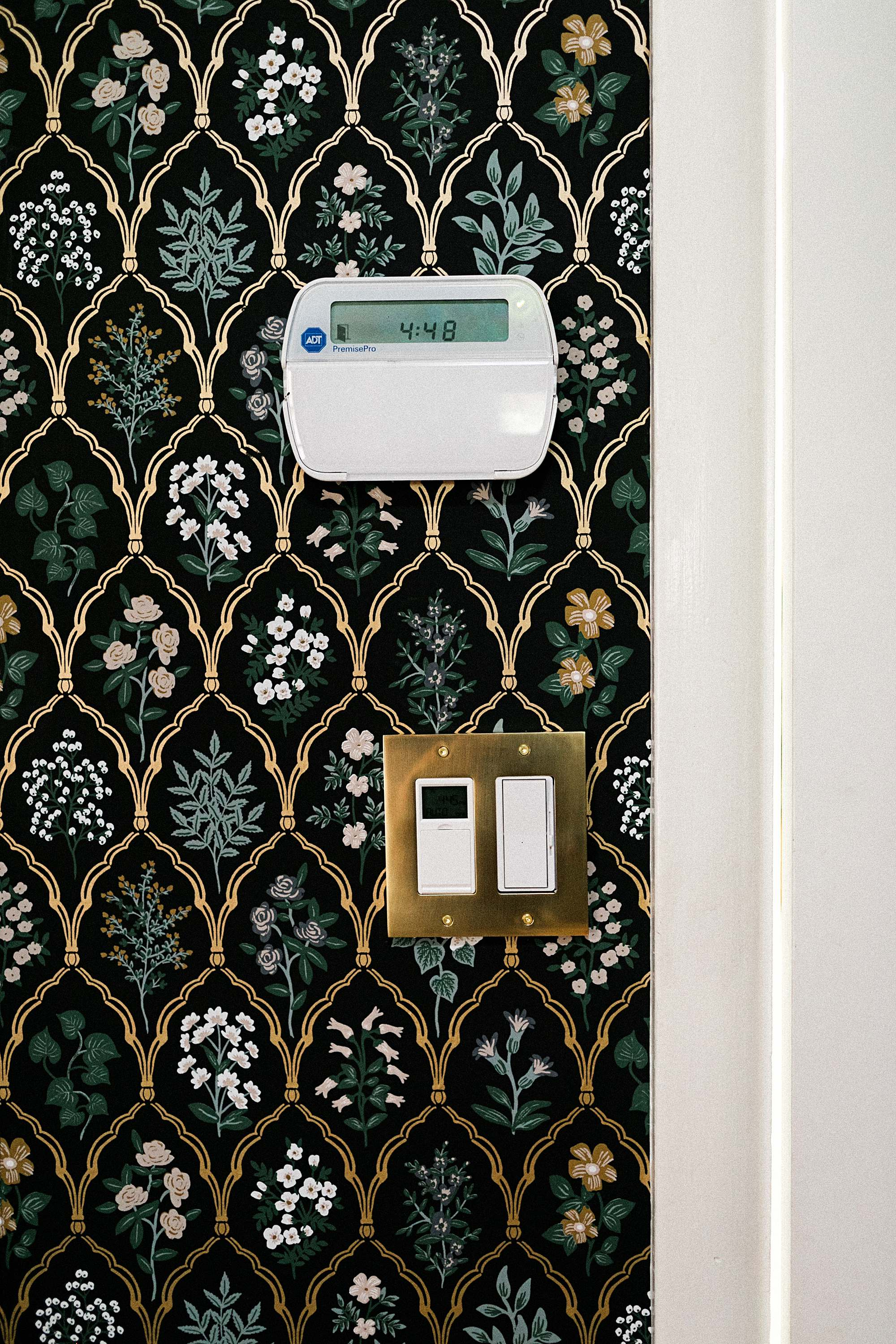 gold switch plate scalloped jute rug rifle paper co. Hawthorne wallpaper black linen floral wallpaper in mudroom laundry room English cottage vibes grandmillennial style - dianaelizabethblog.com