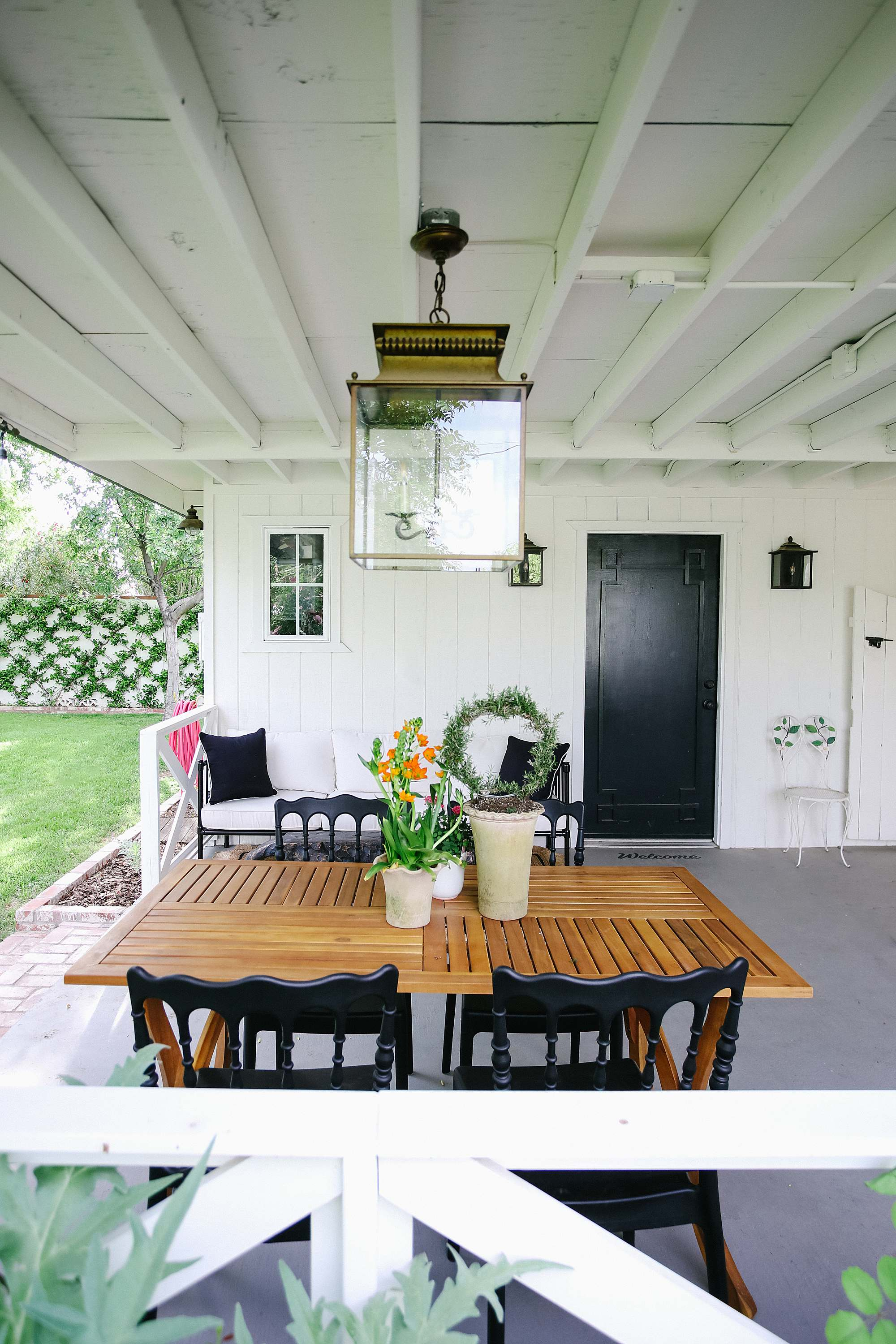 Grandmillennial style porch inspiration contemporary English garden white and black romantic feminine backyard porch vibe