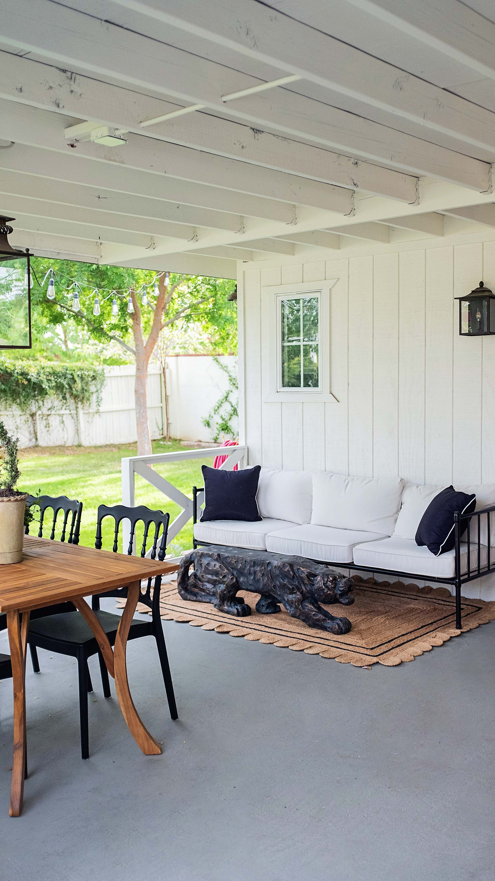 Grandmillennial style porch inspiration contemporary English garden white and black romantic feminine backyard porch vibe, scalloped jute rug