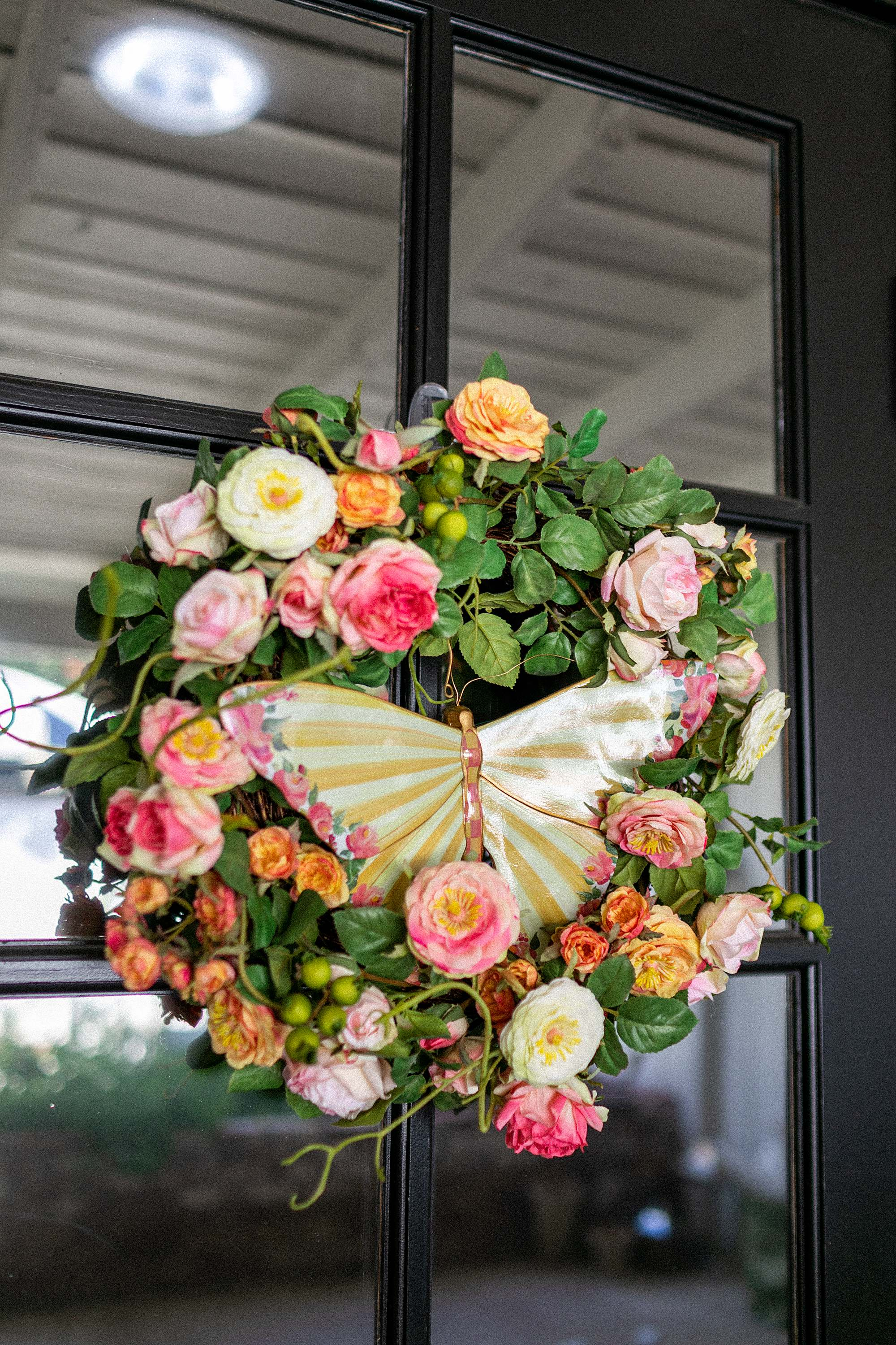 large butterfly Mackenzie-childs decorate for spring, black front door spring wreath ideas DIY