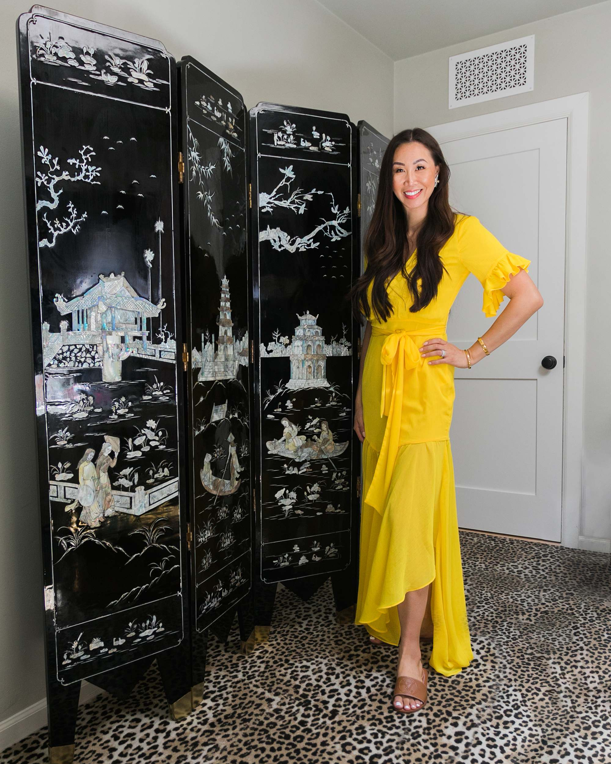 mother of pearl vintage antique Chinese panel phoenix home blogger leopard print carpet woman standing in yellow dress- discussing antiques and ebay finds on the blog