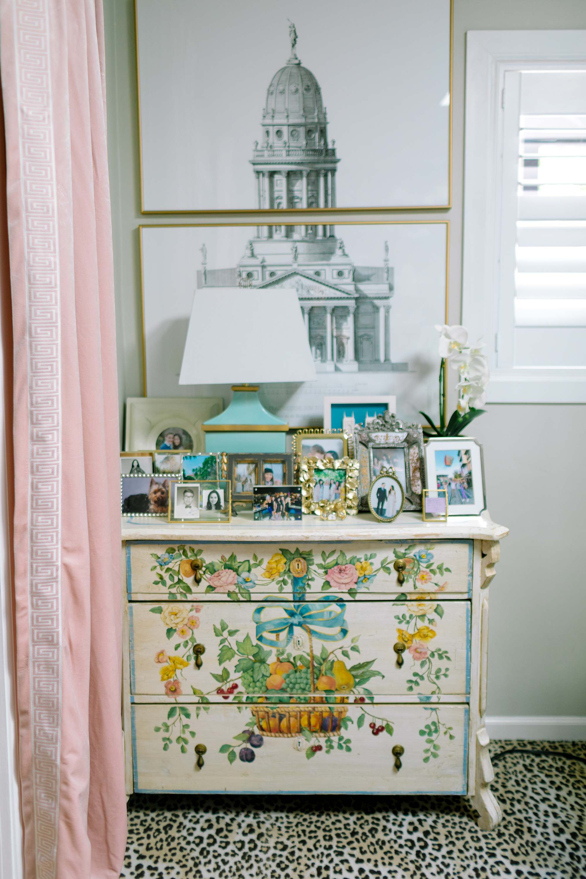 collection of picture frames on English painted chest
