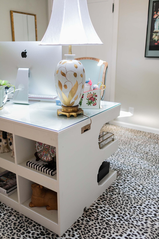 large bookcase front desk on wool leopard print carpet