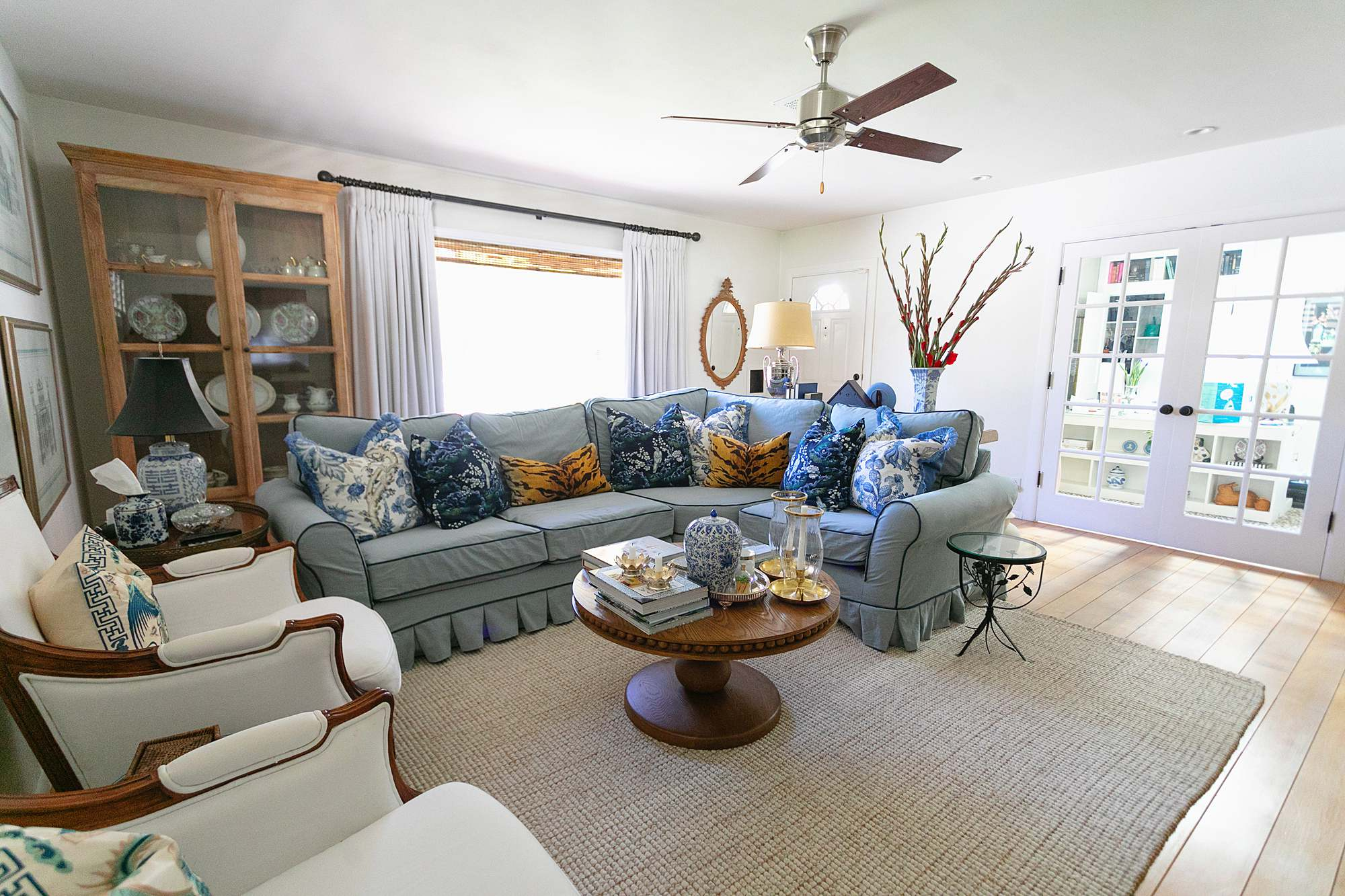 blue and white living room blue couch with dark blue piping and pleat skirt traditional American living room
