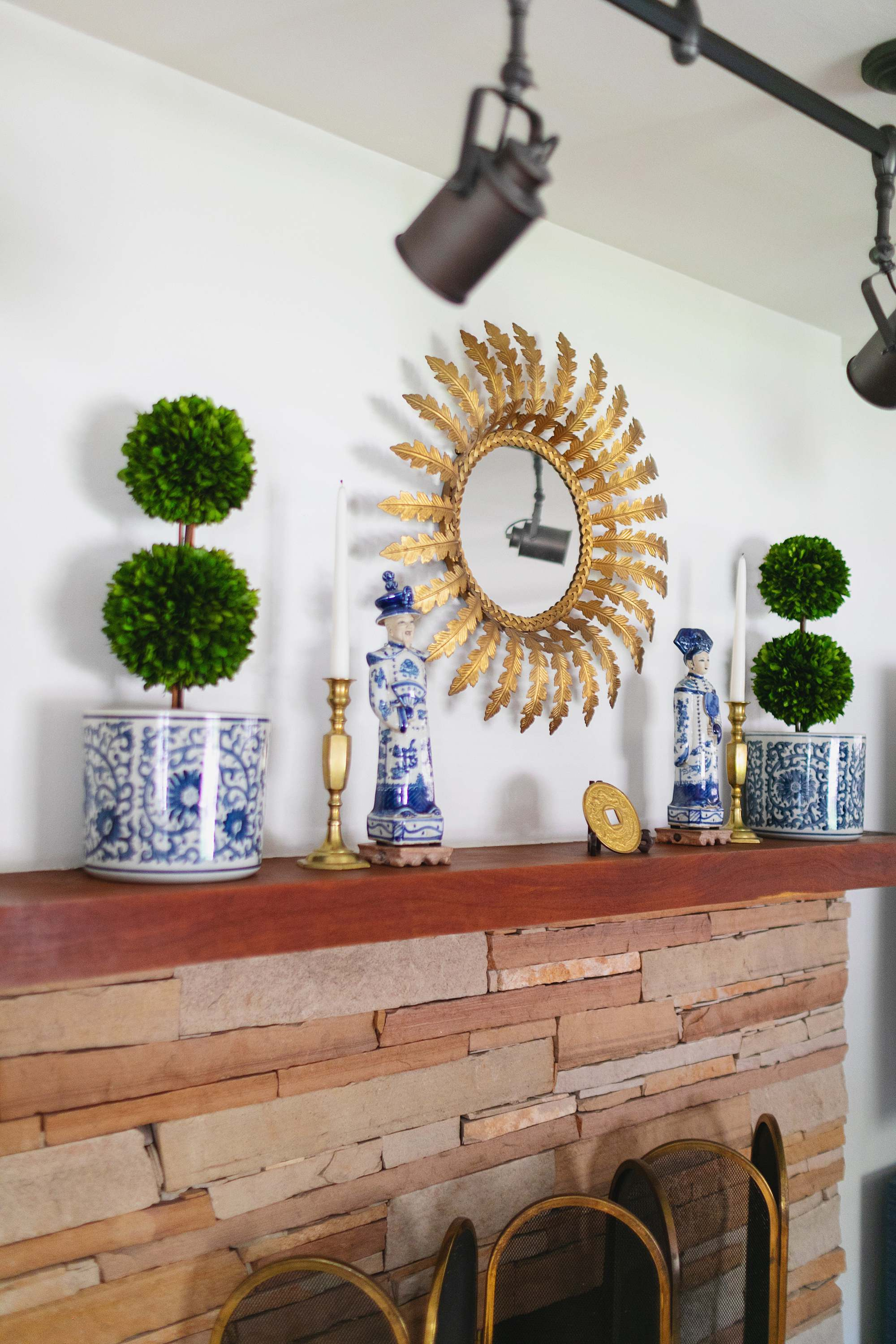 topiaries on fireplace chinoiserie blue and white living room