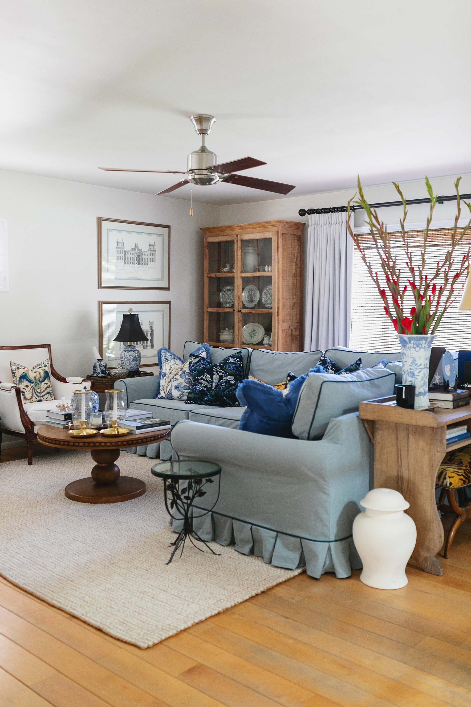 blue and white couch sectional couch blue and white living room pleated skirt sherwin Williams alabaster white on the walls American decoration traditional