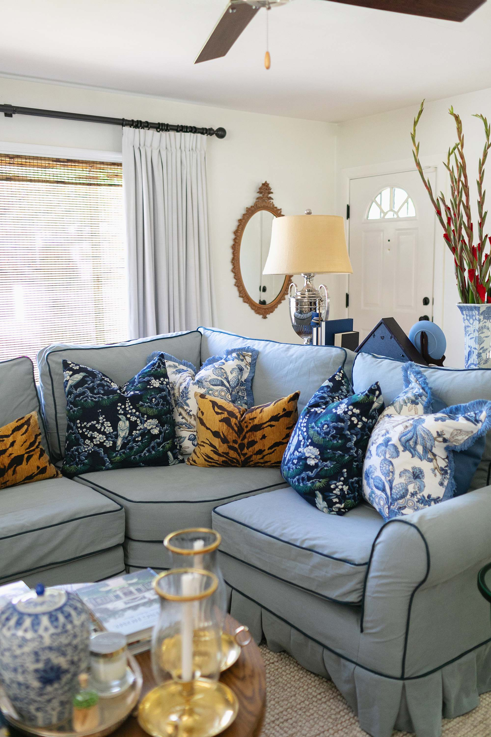 blue and white with tiger print living room blue couch pleated skirt pleats on skirt of couch