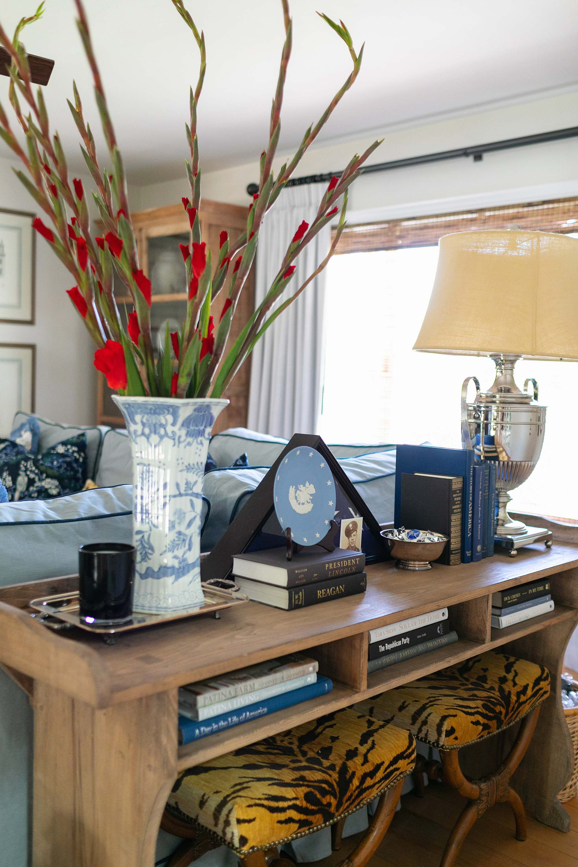 blue and white living room console table American theme living room blue and white trophy lamp tiger print stools