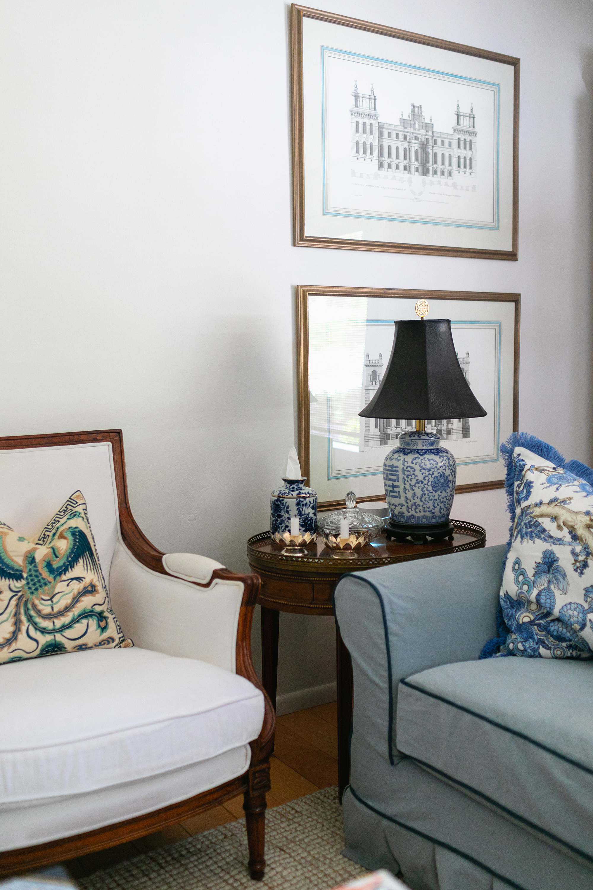 blue and white living room ginger jar style chinese oriental lamp with black shade on antique baker furniture side table