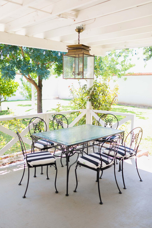 black white stripe outdoor cushions mid century modern vintage outdoor patio furniture vintage iron glass table top phoenix home blogger interior design blog