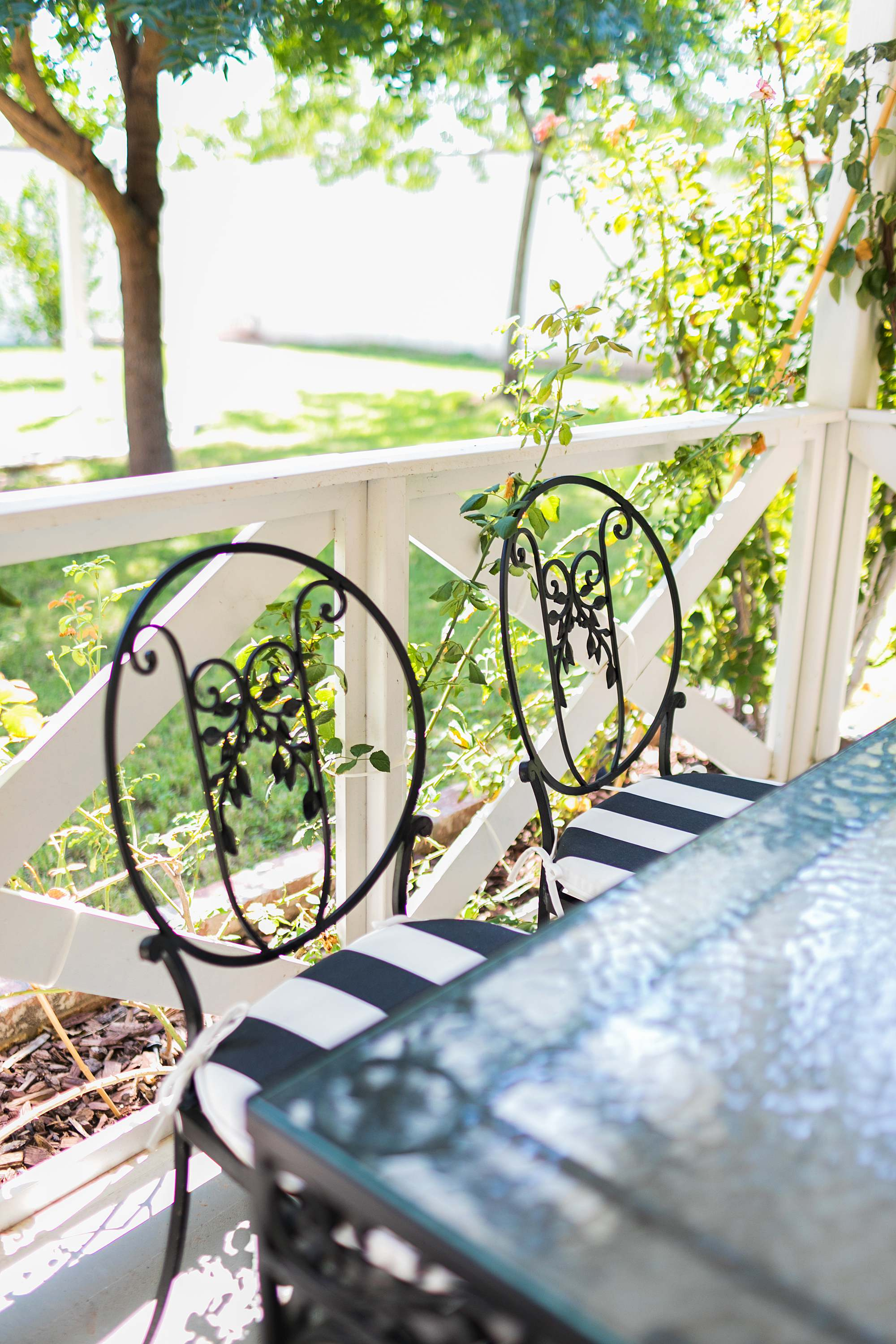 small spaces backyard furniture ideas spray painted black and white scrollwork outdoor table vintage